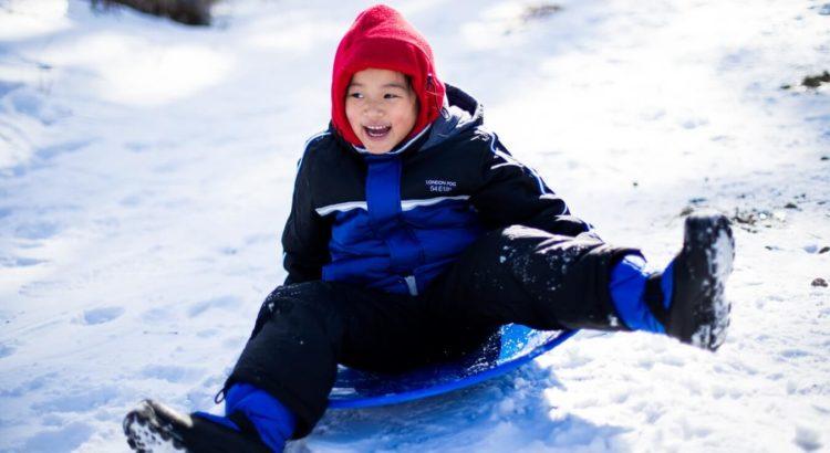 child wearing ski boots
