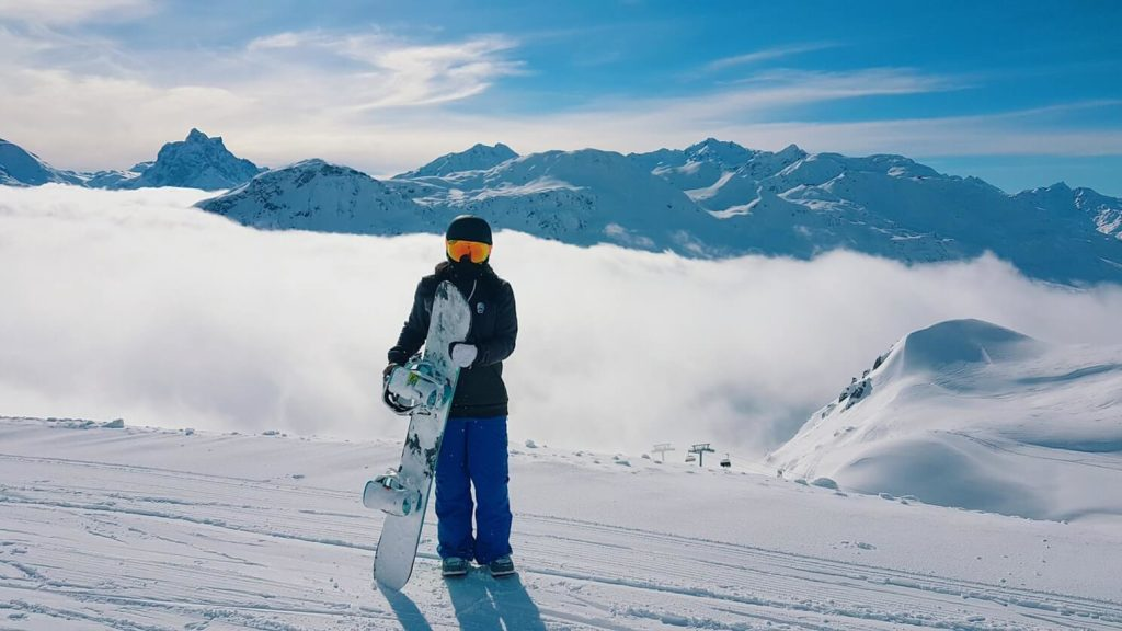 man holding a snowboard